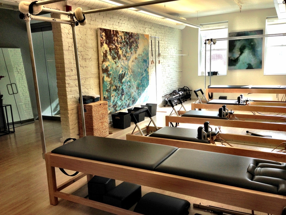 pilates apparatus reformer session cadillac tower wunda chair