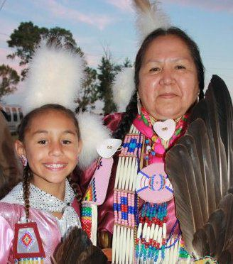 Linda EagleSpeaker and her granddaughter Mataya Rain EagleSpeaker, preparing for grand entry at a pow-wow in Canada