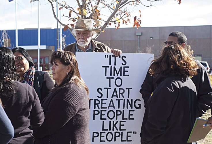 Protesters gather outside the ICE immigrant detention center in Aurora for the announcement of the class action.