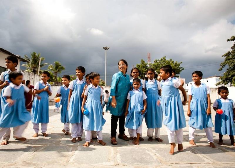 Prajwala - Sunitha Krishnan with rescued children.jpg