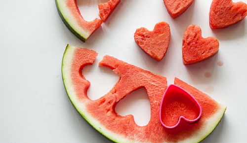 Use a cookie cutter to easily cut heart shapes from watermelon slices.  --photo credit: Highlights.Com, https://www.highlights.com/parents/family-activities/21-heart-shaped-foods-valentine-s-day