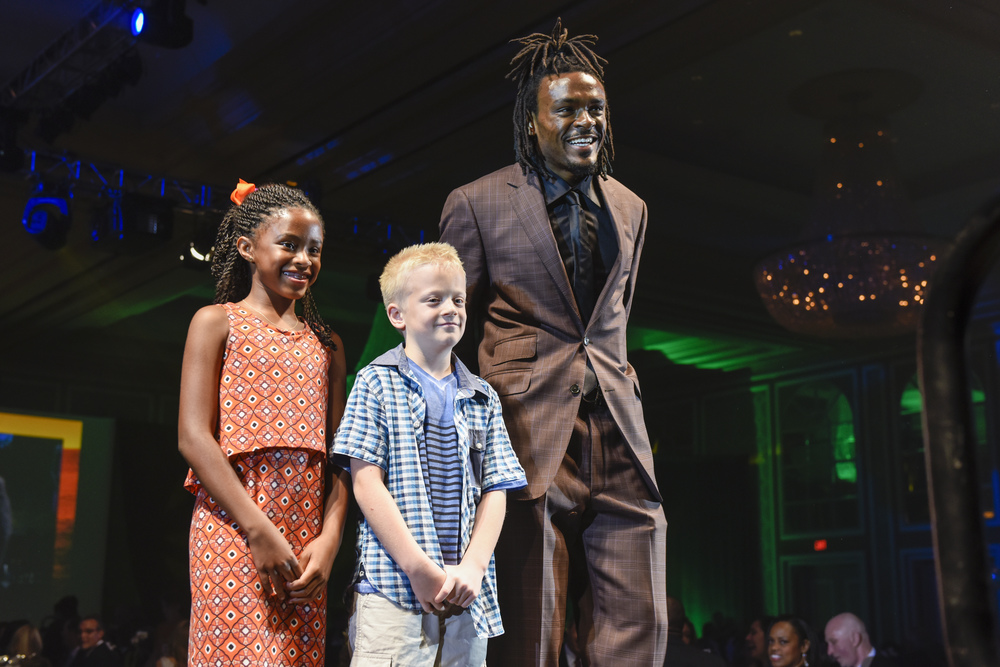 Sidney Carr joins Dad Brandon Carr to escort Trip Rowley  Photo credit Juan Pulido.jpg