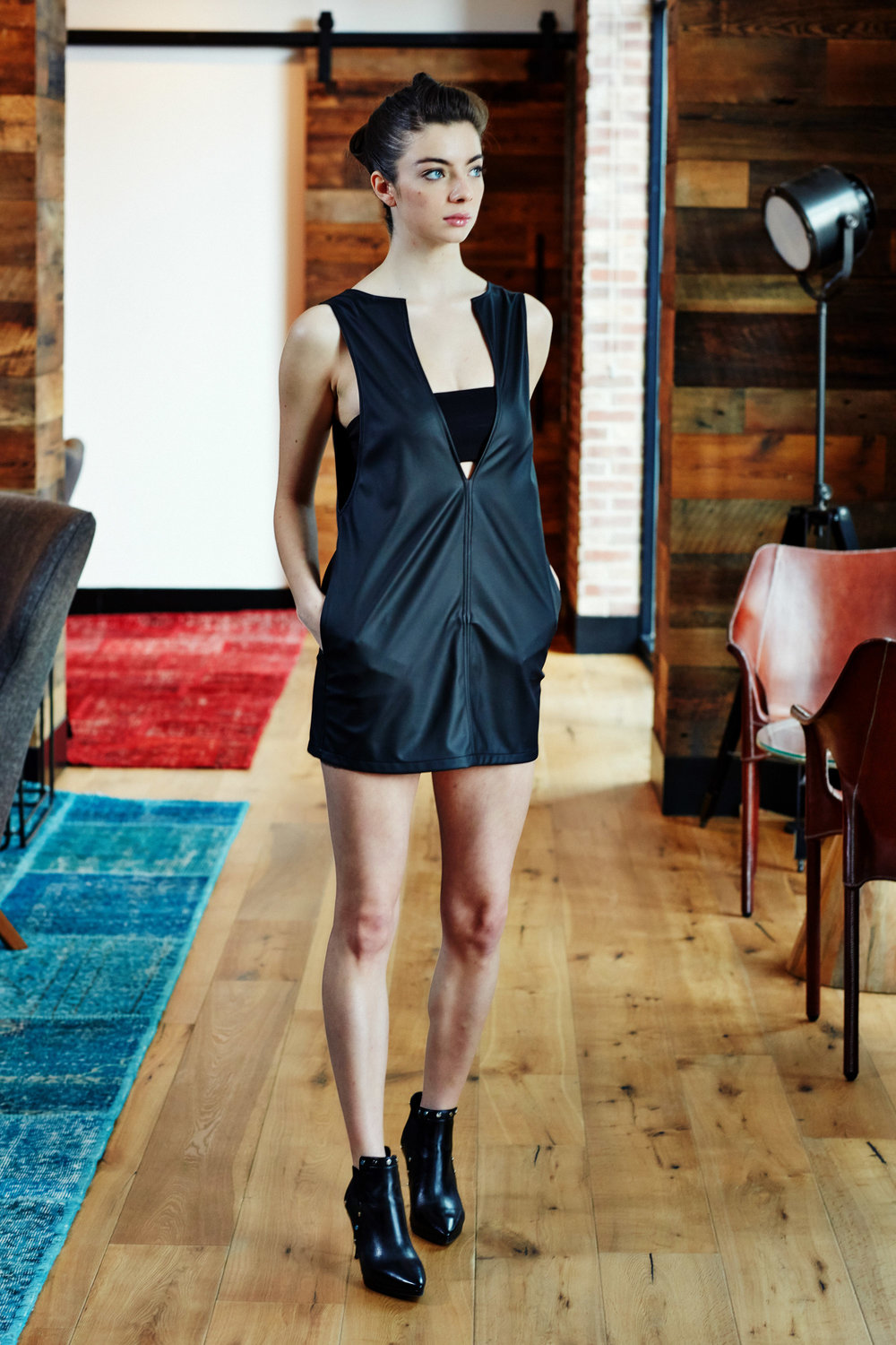 Minika-Ko-Kovasky-Collection-Lookbook-Fashion-Performance-Fabrics-Black-Faux-Leather-Vest-Dress-with-Hidden-Pockets-and-Black-Bandeau-Athleisure-Style.jpg
