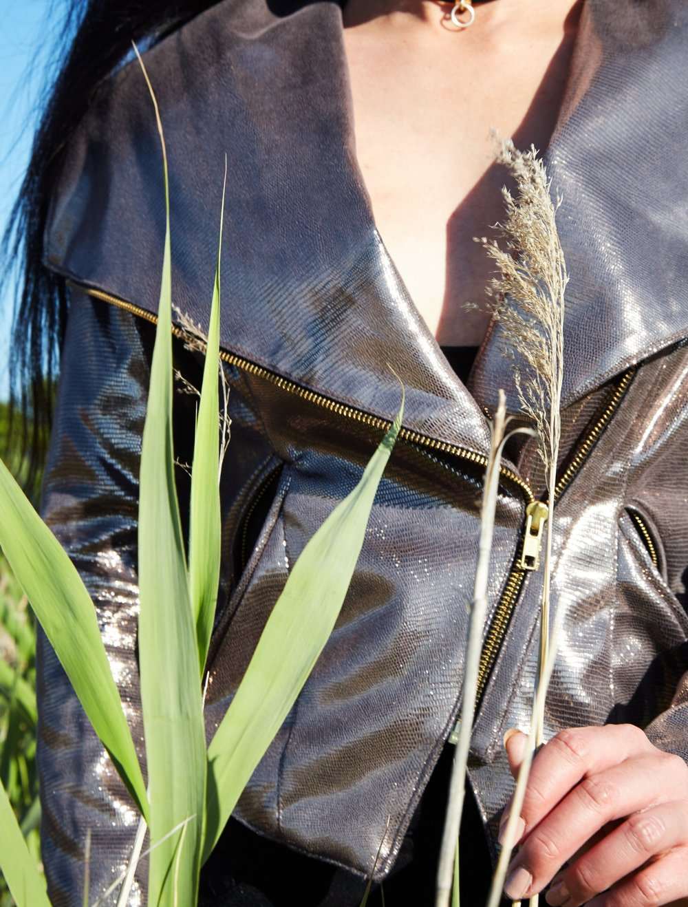 This custom designed Metallic Jacket was made of soft vegan leather with prodigious lapels and metal zippers that symbols rock solid strength, while the hand-sewn French lace detail  on the lower back emphasizing femininity.