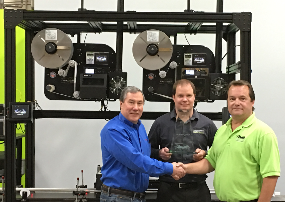 Dan Hanrahan accepting the Integrator of the Year award from Jim Thompson, with Ron Schmoker