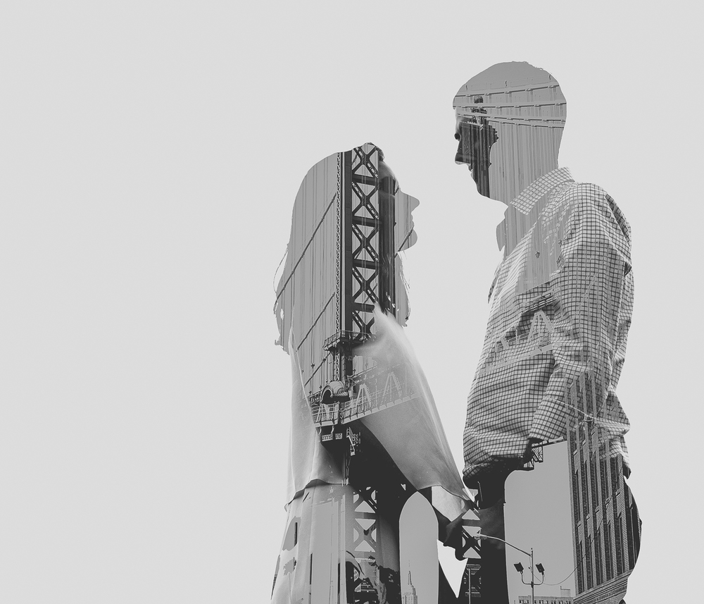 Fun double exposure of couple and Manhattan Bridge, Brooklyn, NY