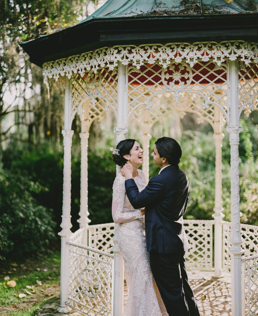 Bride and Groom under Gazeebo in Charleston, NC