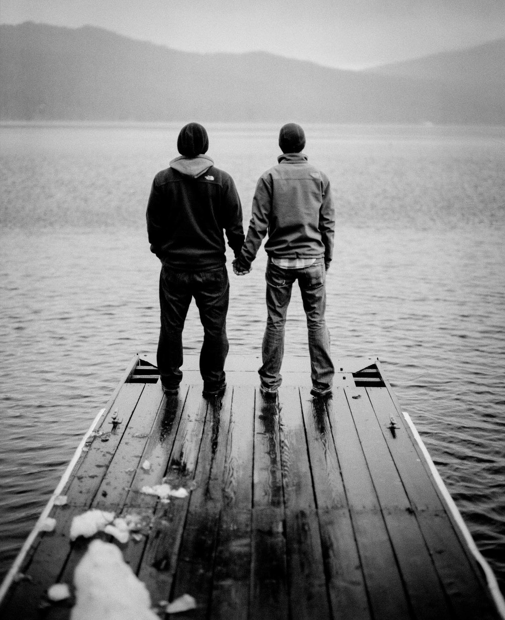 Jeremy and Josh holding hands on the dock, Willamette Pass, OR