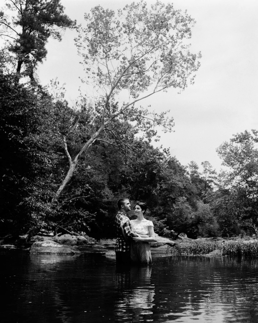 Couple Embracing During Eno River Session, Durham, NC