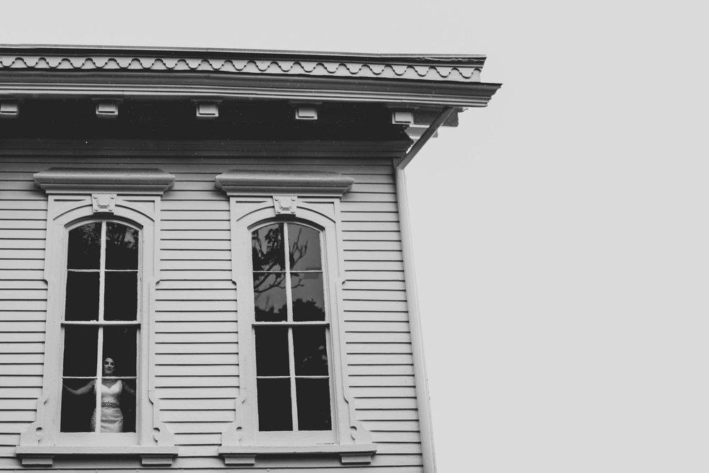 Bride in window of Merrimon-Wynne House, Raleigh, NC