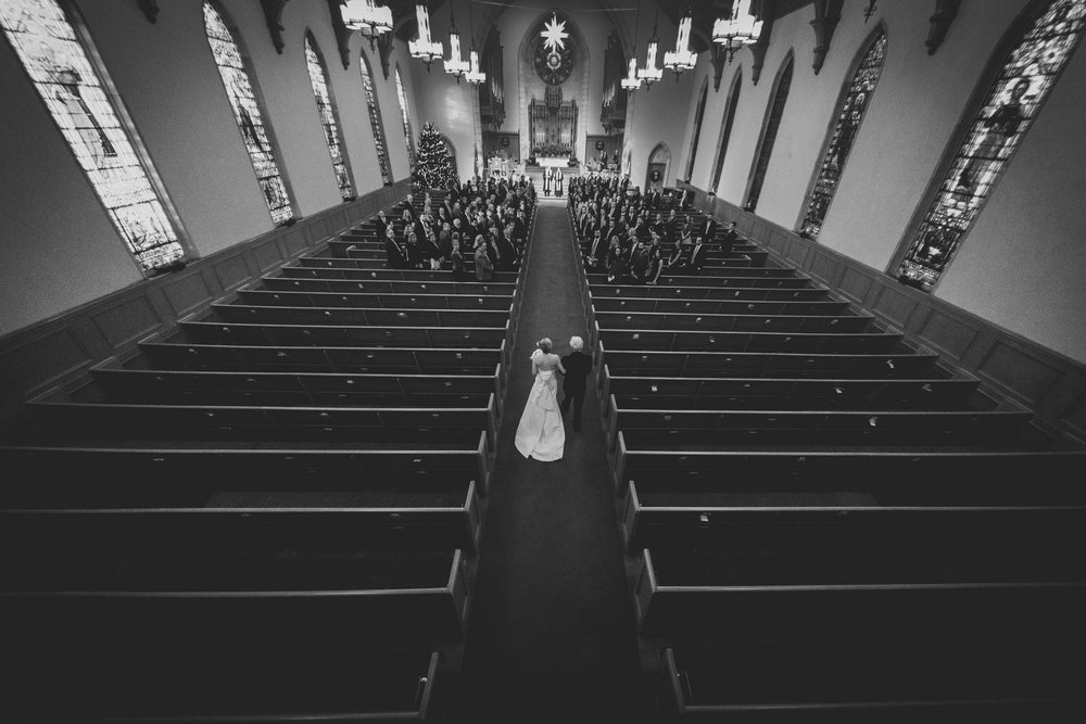 Father walking his daughter down the aisle at Edenton Street United Methodist Church, Raleigh, NC