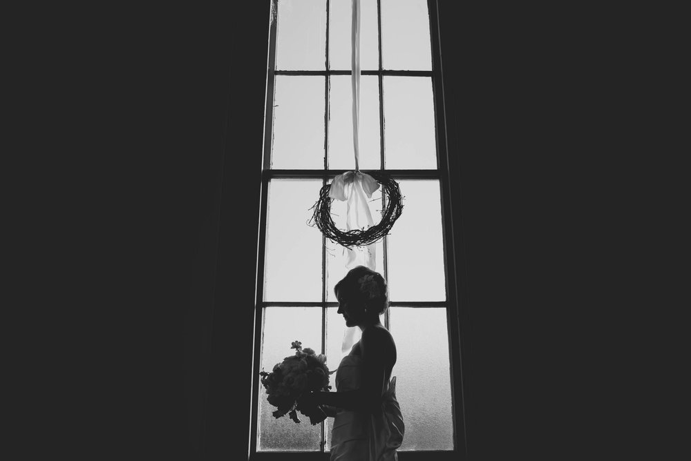Bridal portrait in the window of The Chapel Between Cotton and Gin, Greensville, NC