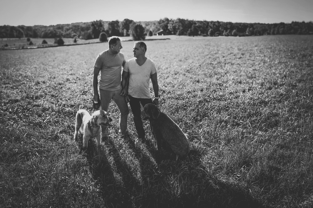 Chuck and Andy walking their dogs at Joyner Park, Wake Forest, NC