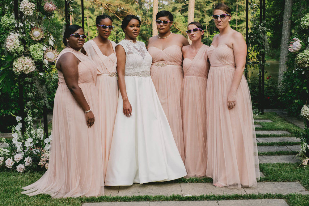 The bride and her bridesmaids looking amazing in their dresses