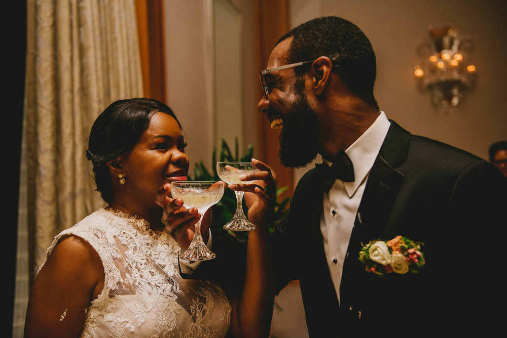 The bride and groom share in a toast at this Raleigh wedding