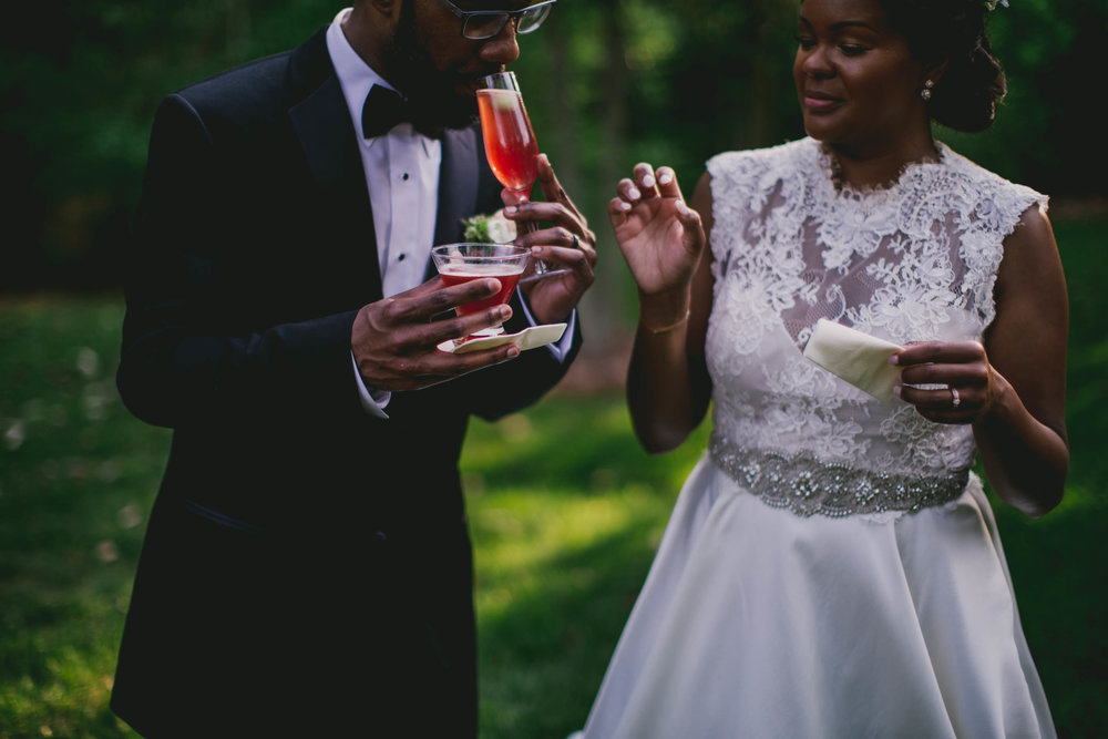 The bride and groom celebrate with their signature cocktails before the reception