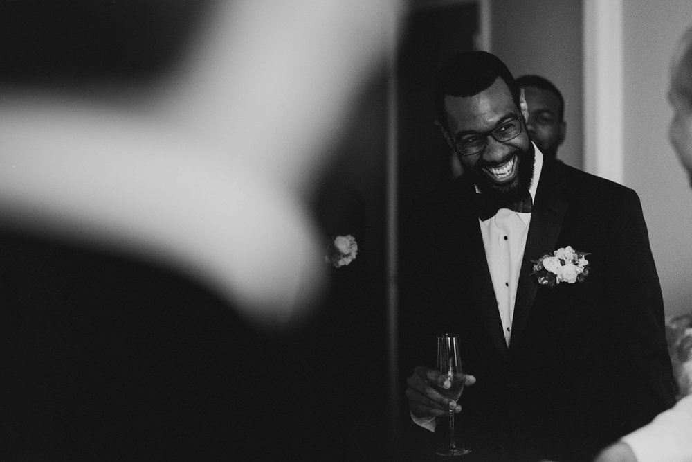 groom laughing with his groomsmen before his wedding at The Umstead Hotel and Spa