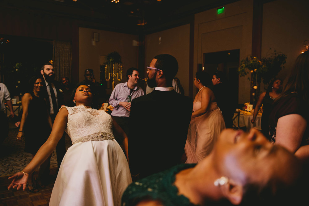 The bride and groom shake it out at their Umstead Hotel wedding