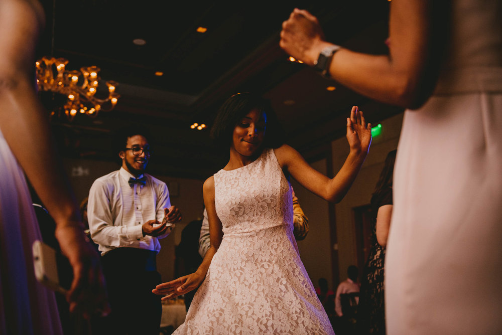 A wedding guest dancing it out during this Raleigh wedding