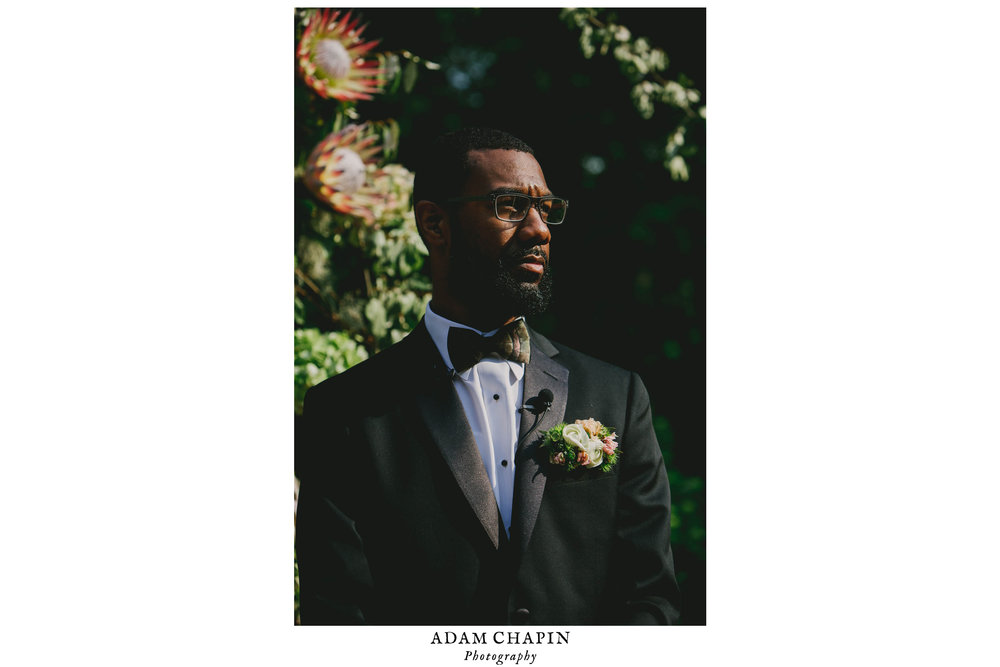 Groom awaiting his bride during this Raleigh wedding