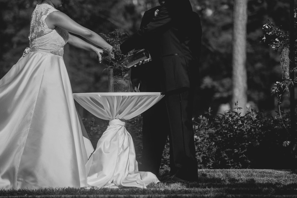 The bride and Groom participating in a tree planting ceremony during their wedding ceremony at the Umstead Hotel and Spa
