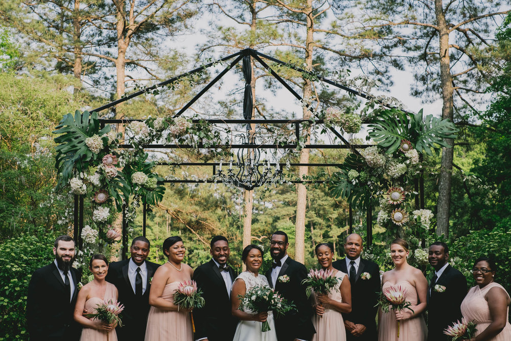 The wedding party of this elegant Umstead Hotel wedding