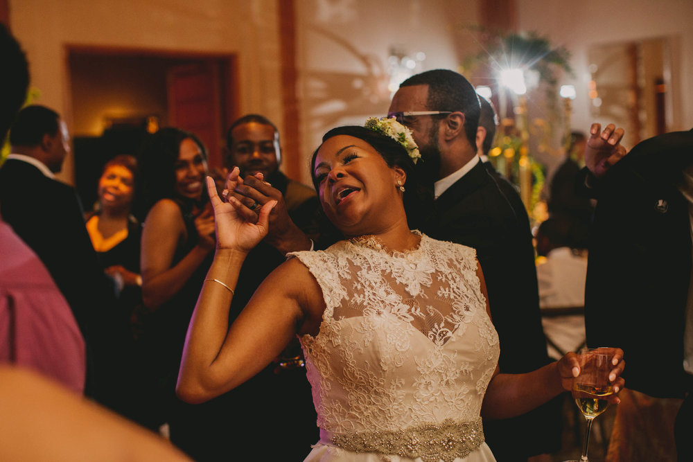 The bride and groom living it up during the last dance at their elegant Umstead Hotel and Spa wedding in Cary, NC