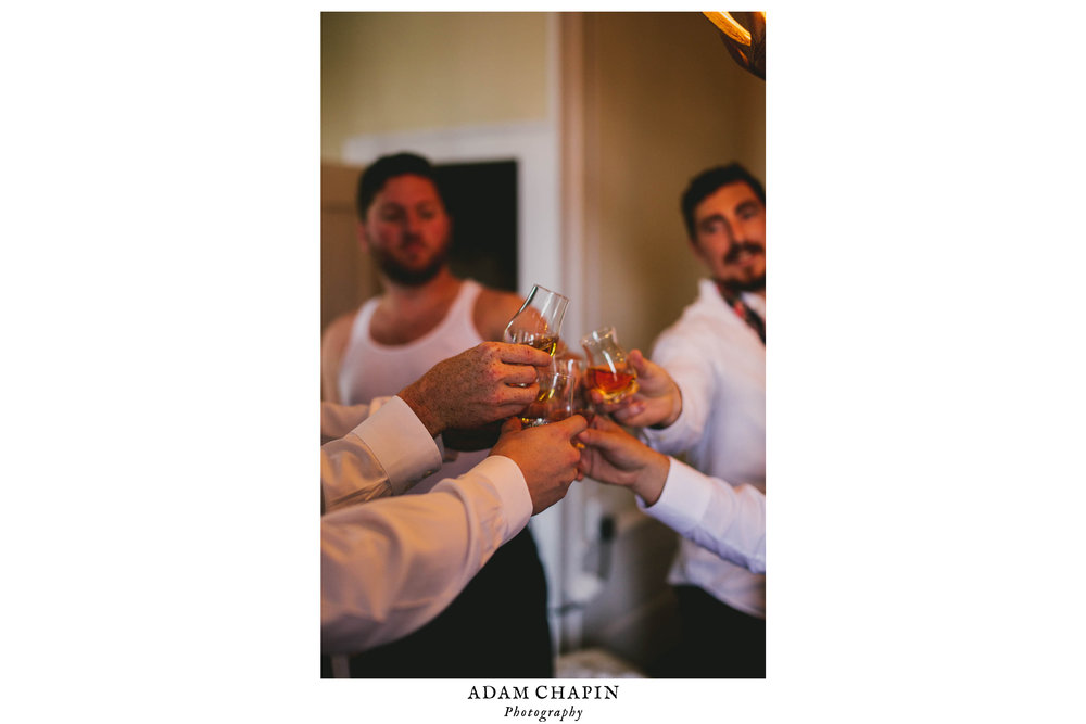 mims-house-wedding-groomsmen-cheering.jpg