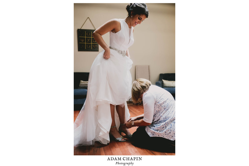 mother-of-the-bride-getting-daughter-ready-photos.jpg