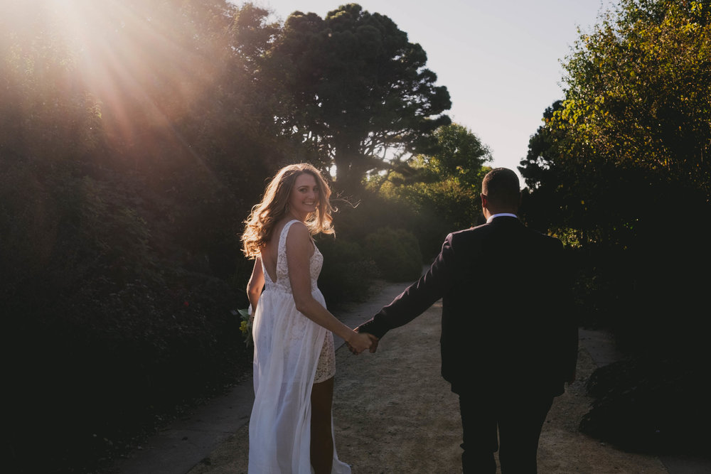 bride-and-groom-run-off-into-sunset-photo.jpg