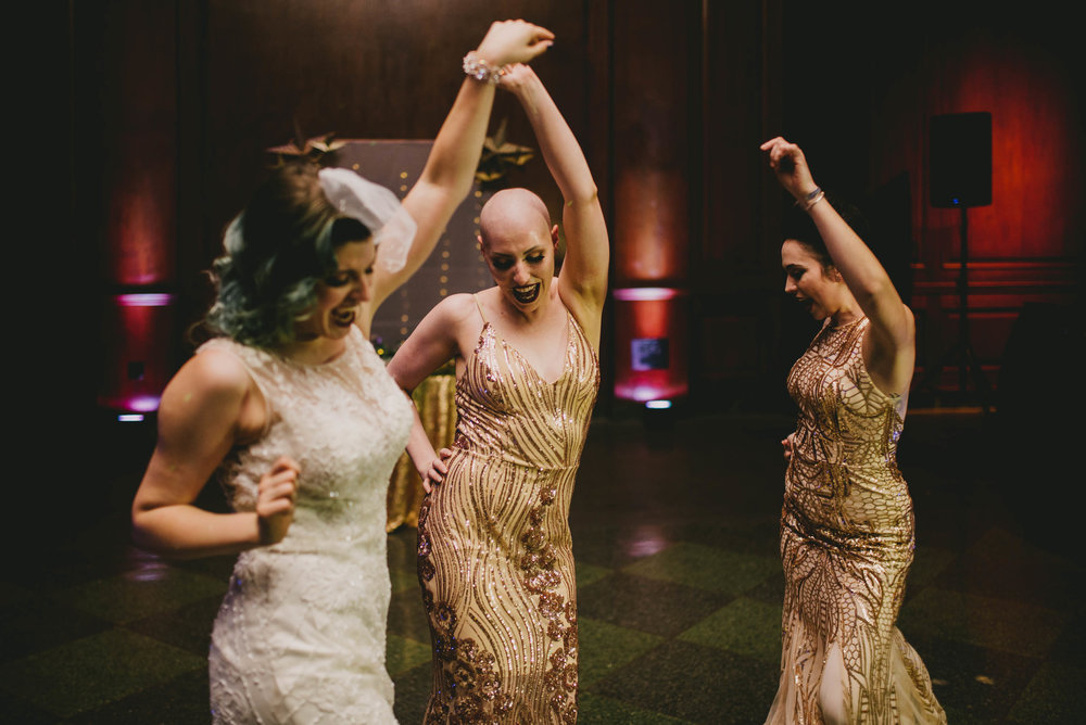 21c-hotel-durham-offbeat-wedding-bride-and-bridesmaids-dancing.jpg