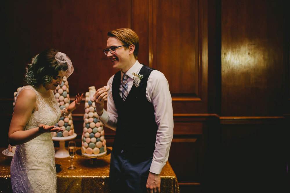 21c-hotel-durham-offbeat-wedding-bride-and-groom-eating-macaron-cake.jpg