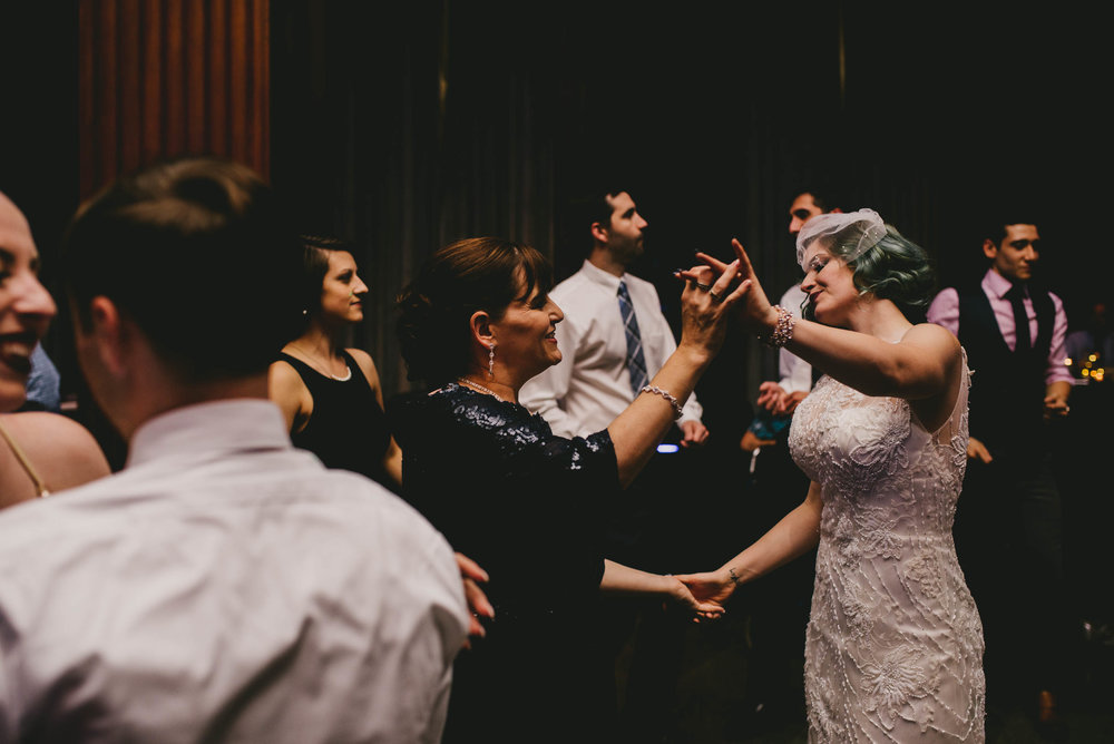 21c-hotel-durham-offbeat-wedding-bride-dancing-with-mother-of-the-bride.jpg