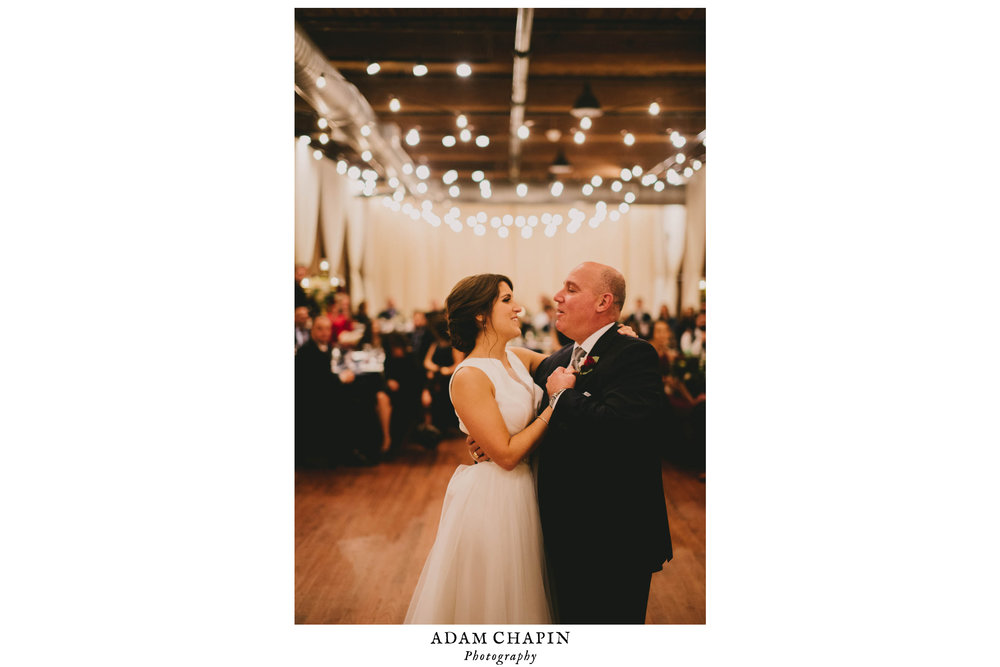 bride and father of the bride smiling during their first dance