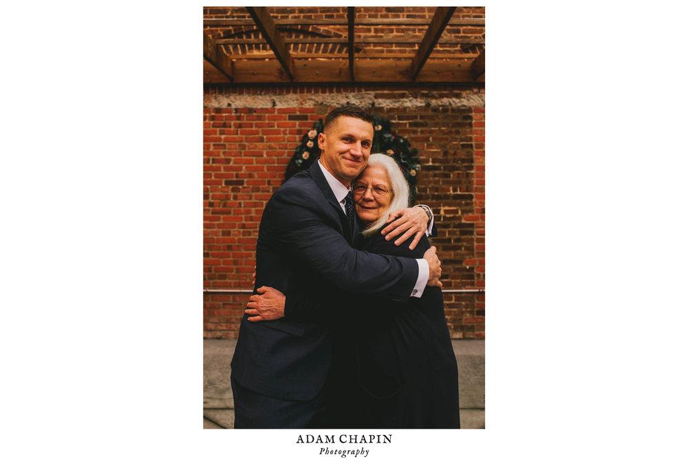 groom and mother of the groom share a hug