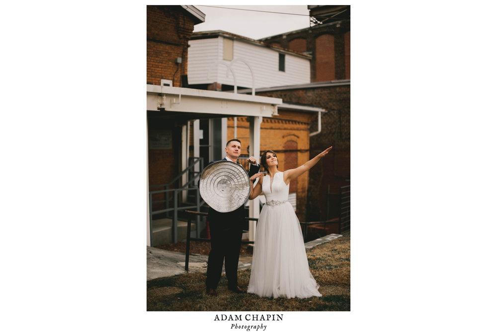 bride and groom posing as superheros