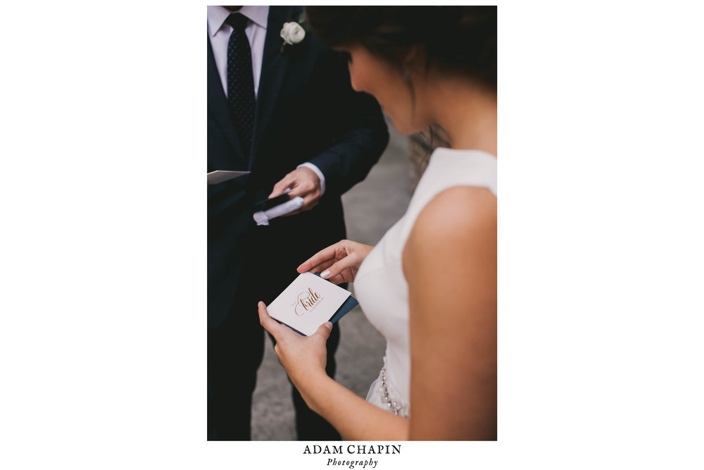 bride and groom exchange cards
