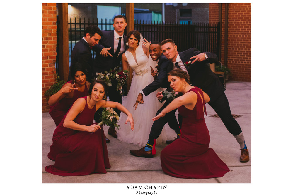 wedding party strikes a pose after the ceremony