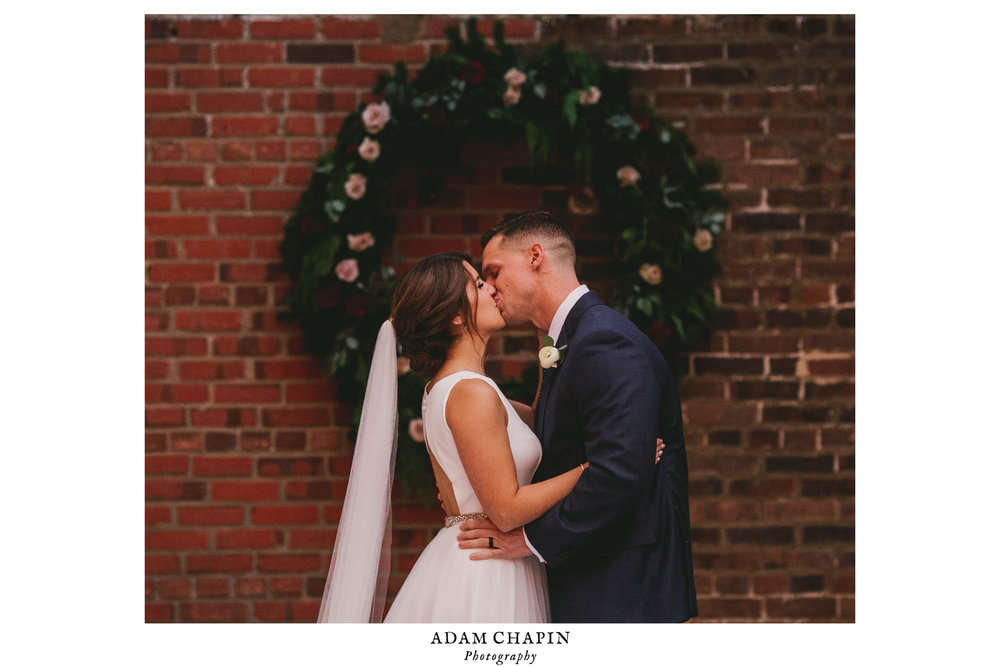 bride and groom seal ceremony with a kiss