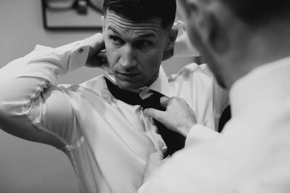 groom getting tie tightened