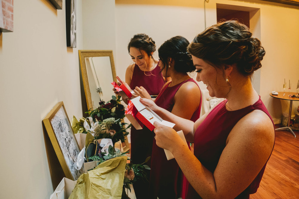 bridesmaids checking out gifts from bride