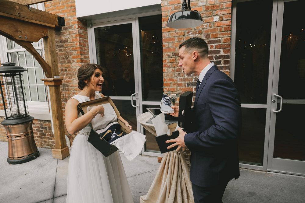 bride and groom exchange custom Nike sneakers