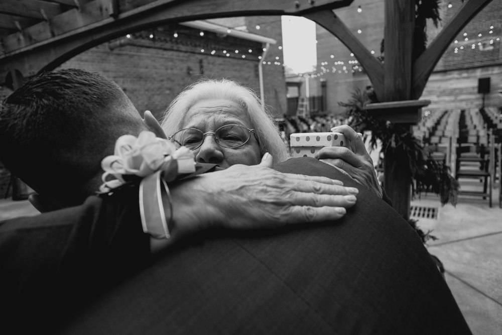 mother of the groom hugging the groom