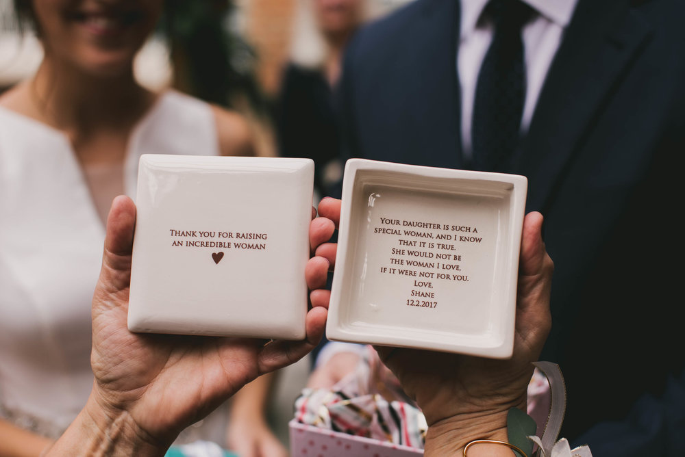 the inscription of one of the custom gifts from the couple to the mother of the bride