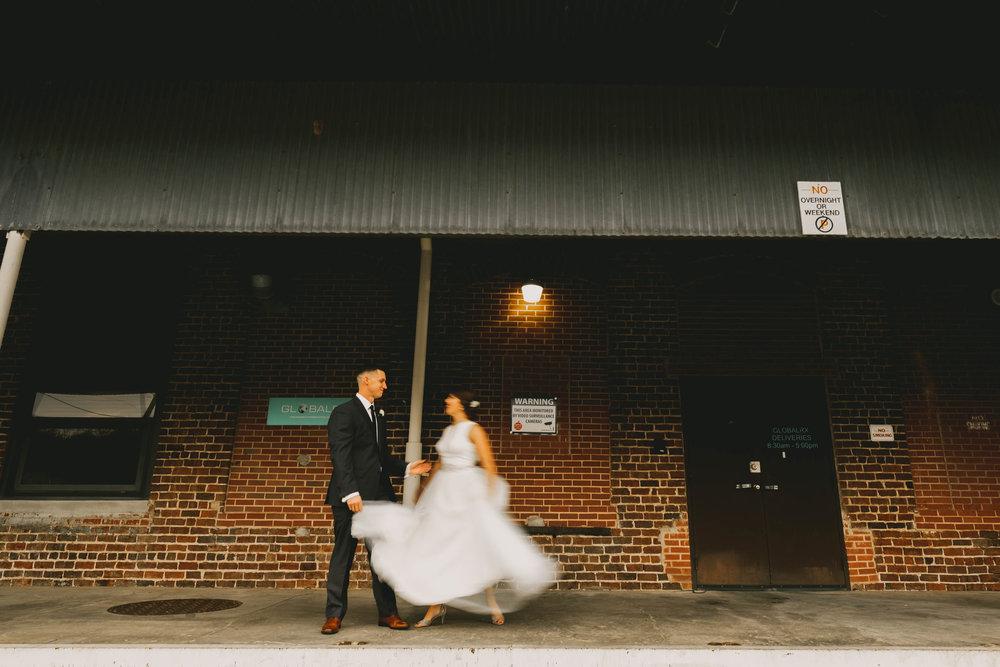 former dancer bride spinning to groom