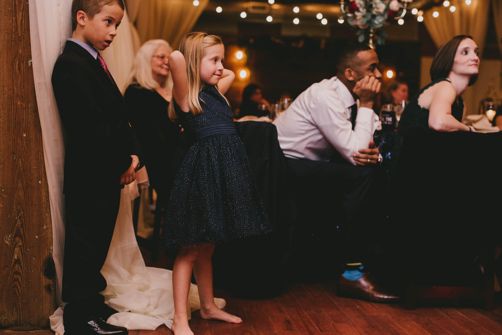 young wedding guests looking on during toasts