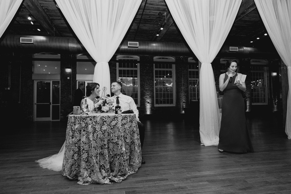 maid of honor sharing a toast to the bride and groom