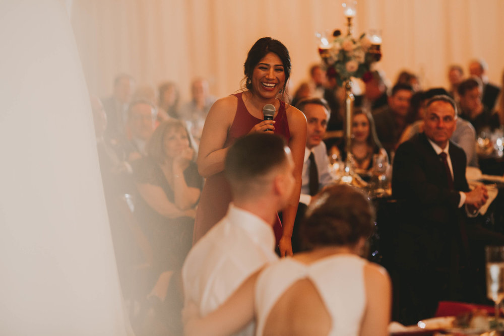 bridesmaid sharing a toast to the bride and groom