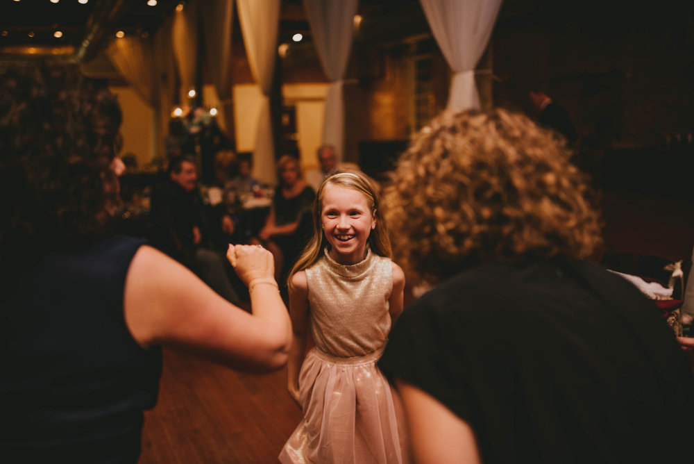 young wedding guest dancing during reception
