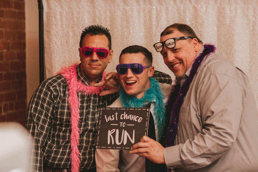 groom with his brothers in the photobooth